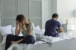 Despaired,Married,Couple,Is,On,Bed
